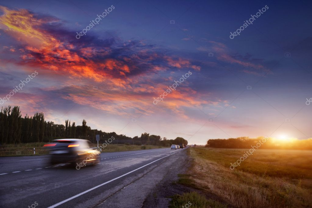 Car on the road at sunset