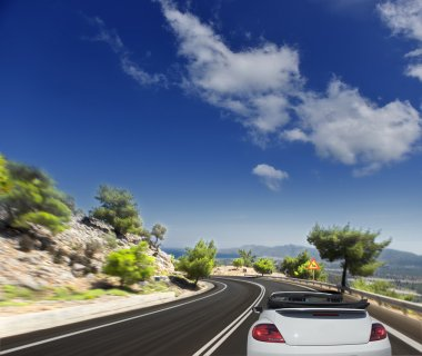 Winding road on the background of the Greek mountains. blurred motion stock vector