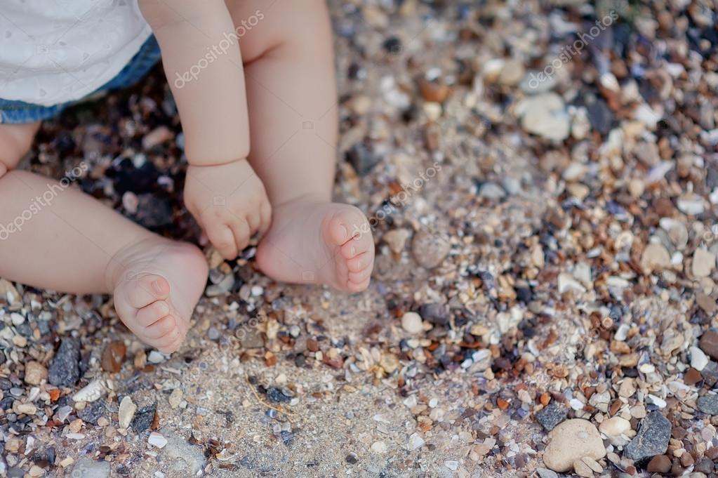 Children's feet in the sand