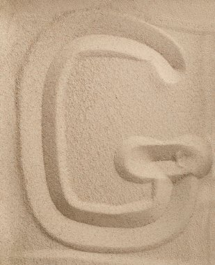 Letter G from sand