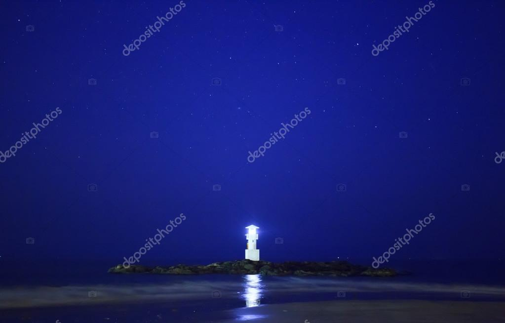 Lighthouse and shining star in early morning — Stock Photo © Surabky