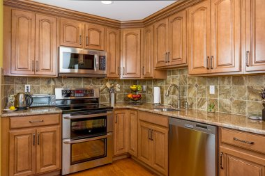 Kitchen mocha wood cabinetry