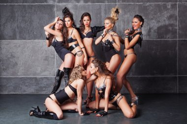 Seven Cute go-go sexy girls in black with diamonds costume playi