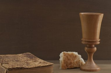 Vintage Bible, bread and wooden communion cup
