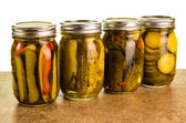 Photo Homemade pickles in mason jars