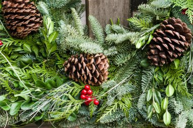 Holiday wreath of evergreens and cones