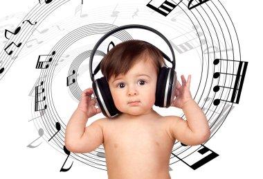 Adorable baby girl with big headphones