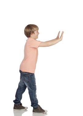 Boy pushing something