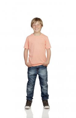 Smiling boy with jeans standing