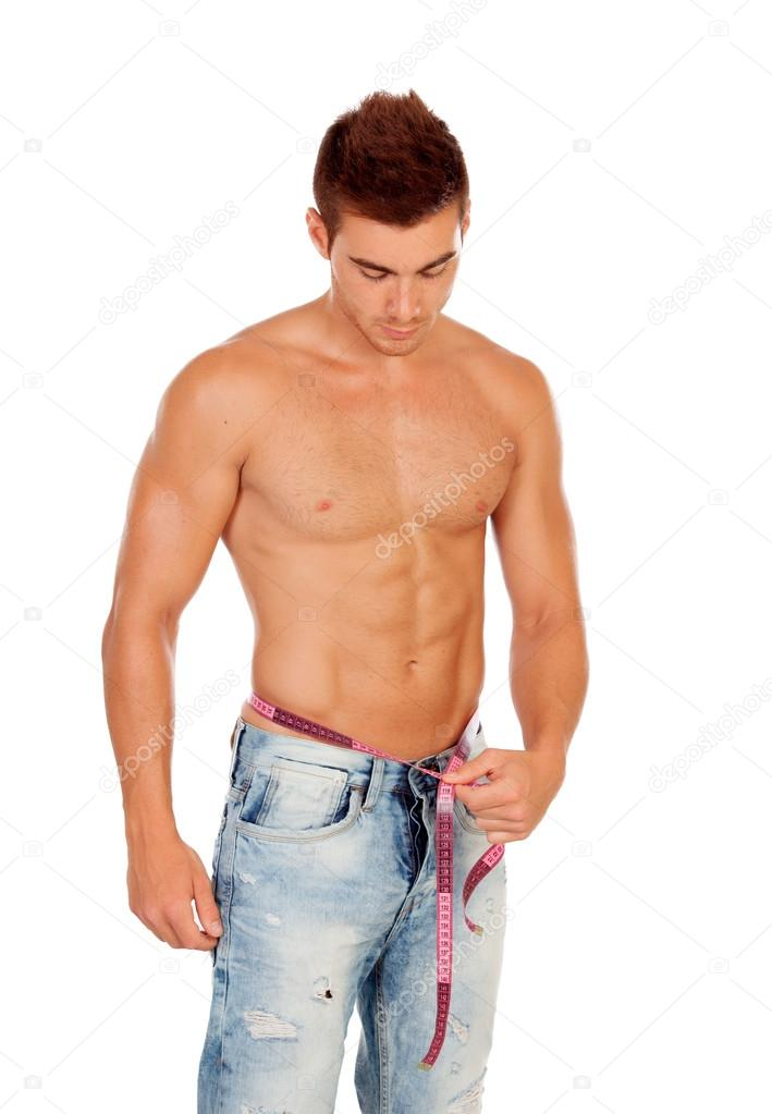Men with perfect abs measuring his waist — Stock Photo