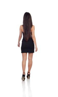 Sensual brunette girl back wiht black dress