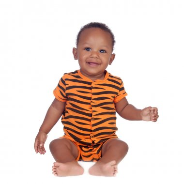 Adorable african baby with with brindle pajamas sitting on the f
