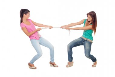 Two beautiful women pulling a rope