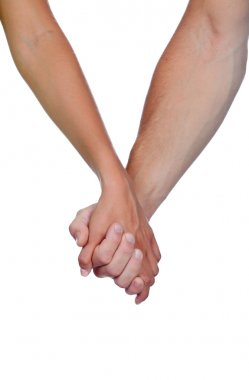 Hands clasped of two lovers