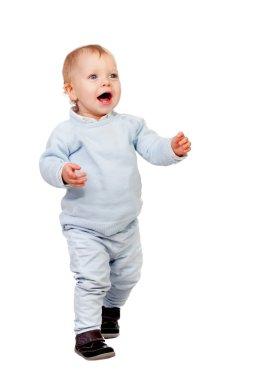 Adorable blonde baby walking