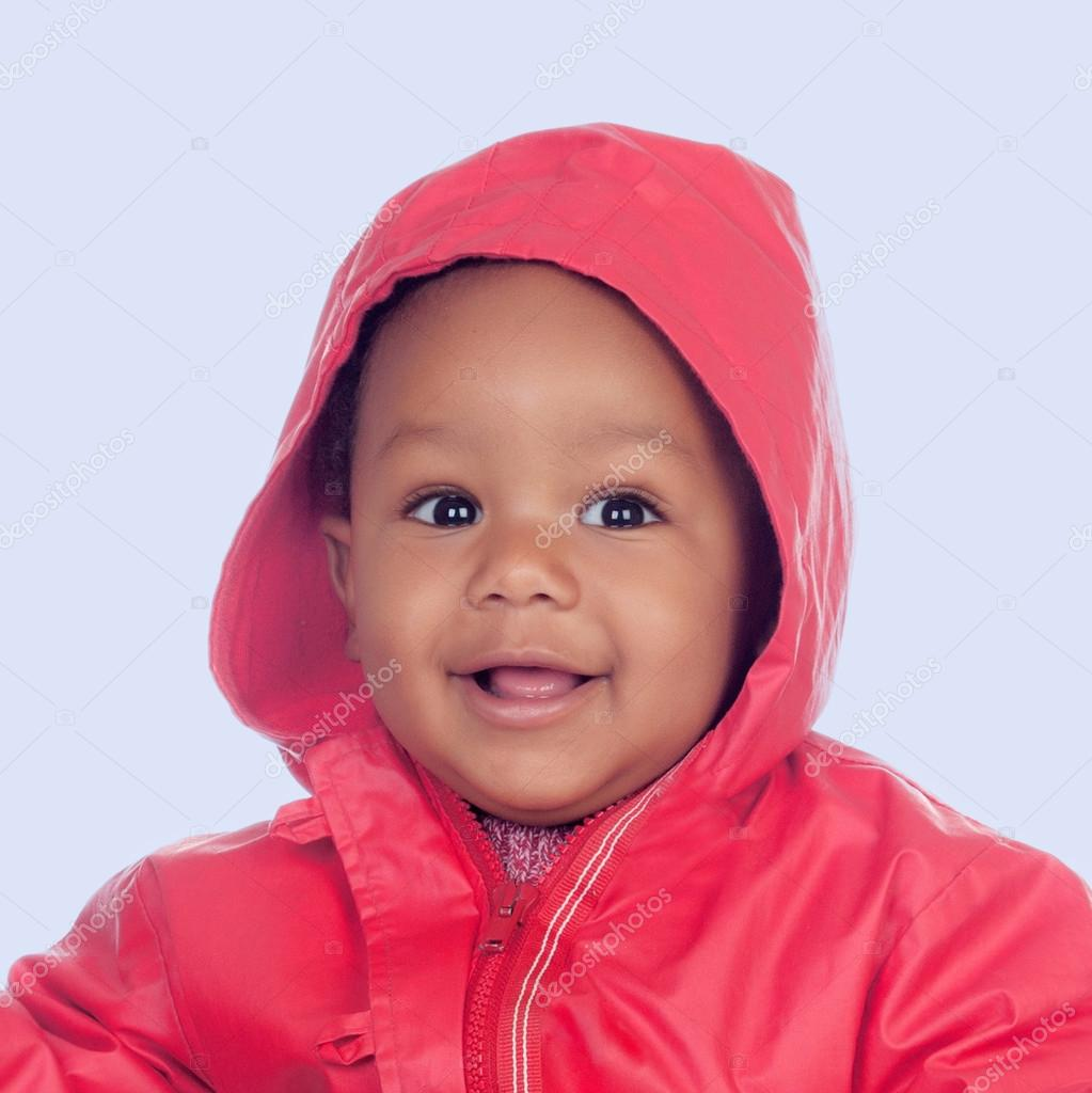 38d892554 Adorable african baby with a beautiful smile and a red raincoat ...