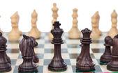 Fotografie Šachové figurky na šachovnici