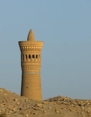 Minaret and desert sand, Bukhara, Uzbekistan