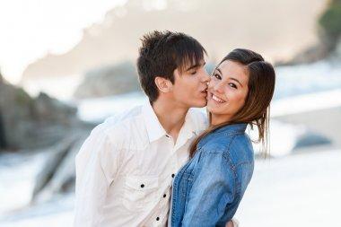 Cute teen couple in love on beach.