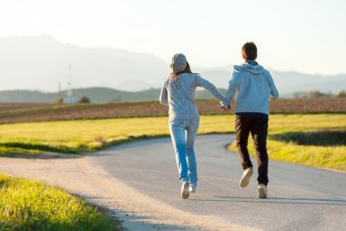 Couple running outdoors.