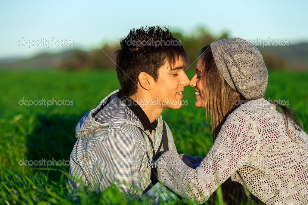 Young couple in countryside showing affection.