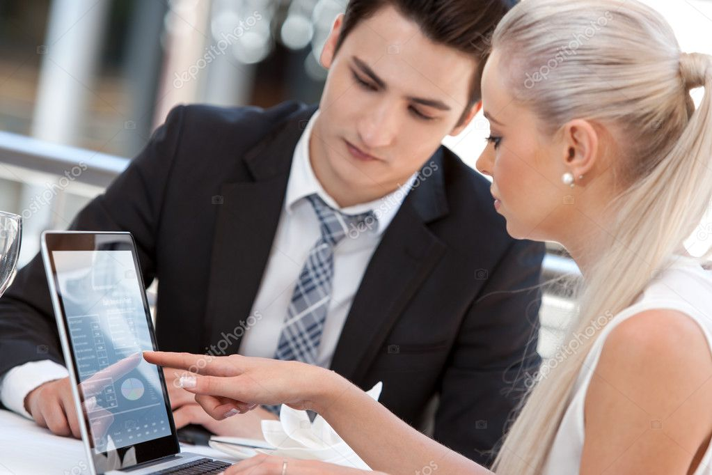 Businesswoman showing work to partner.