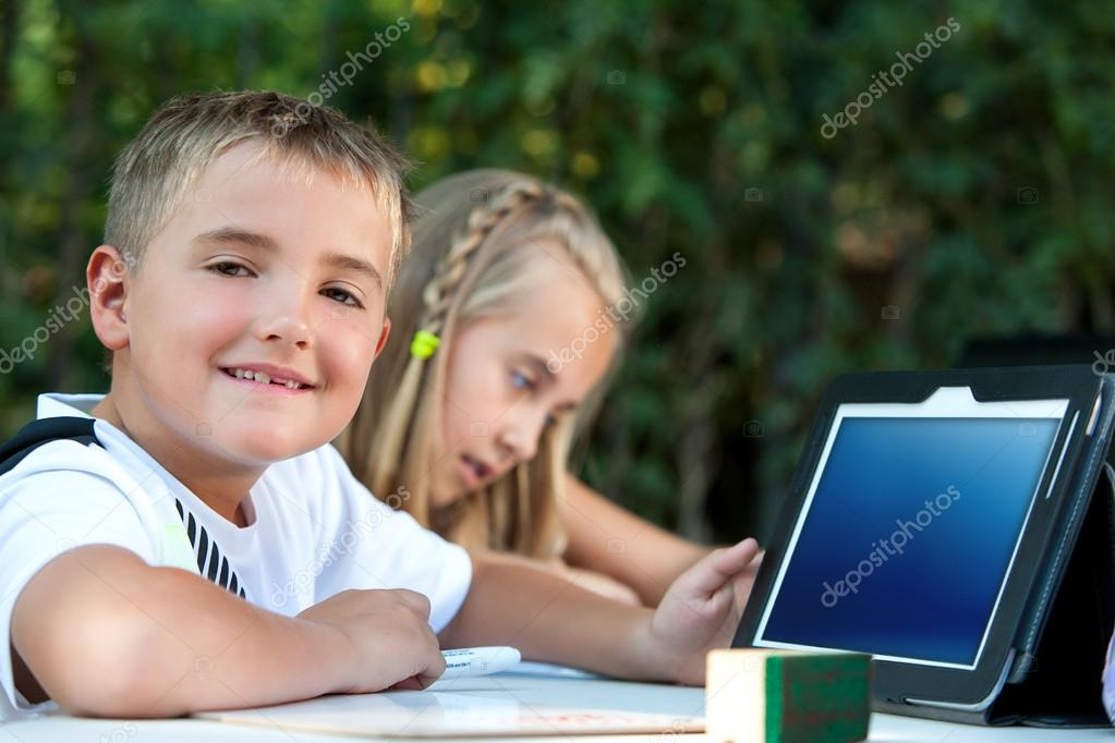 Portrait of boy student showing tablet with copy space outdoors. stock vector
