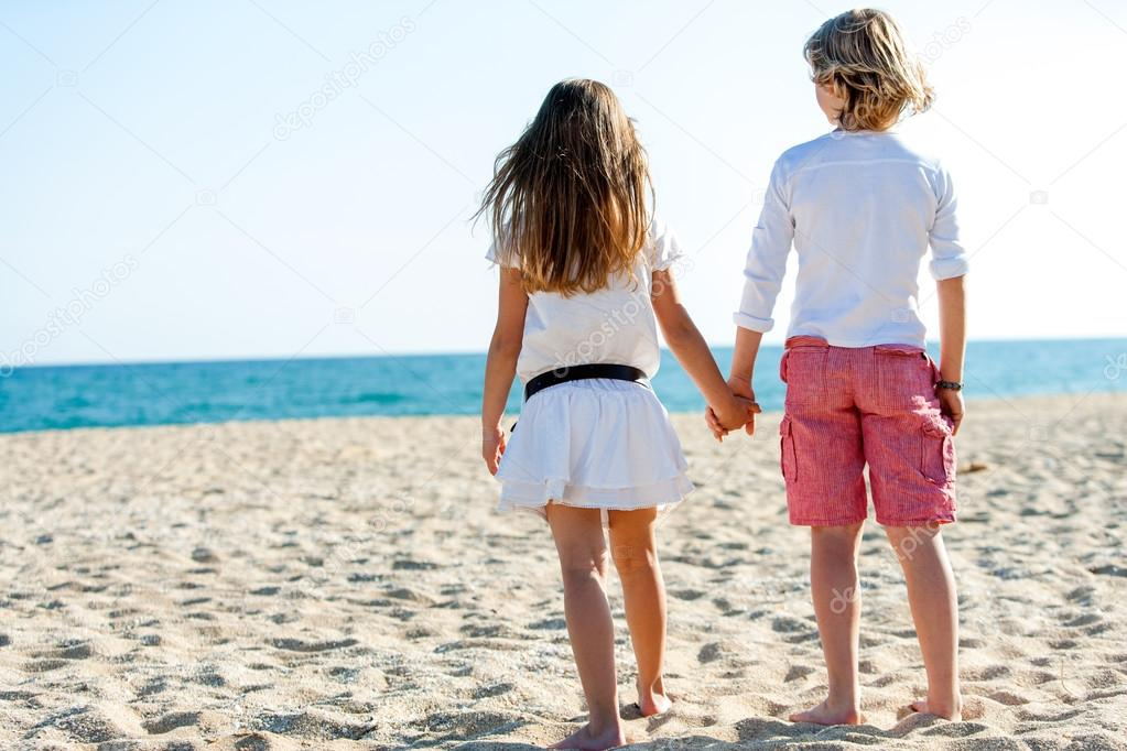 Boy and girl looking at sea.