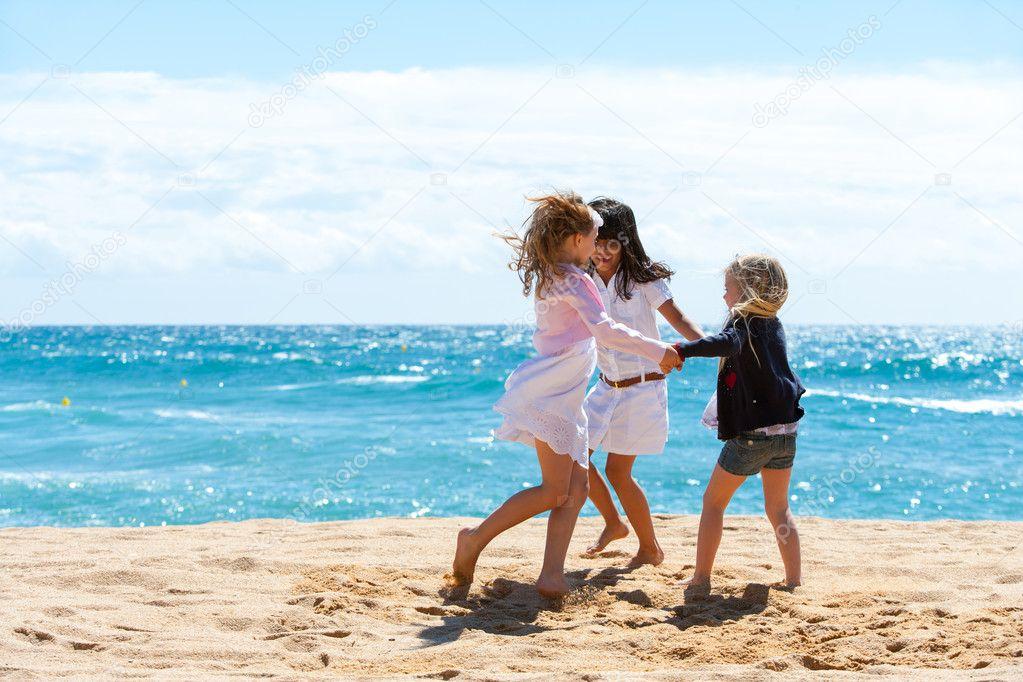 Children playing game on beach.