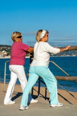 Elderly women stretching before jogging.