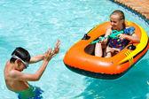 Photo Children having fun in pool.