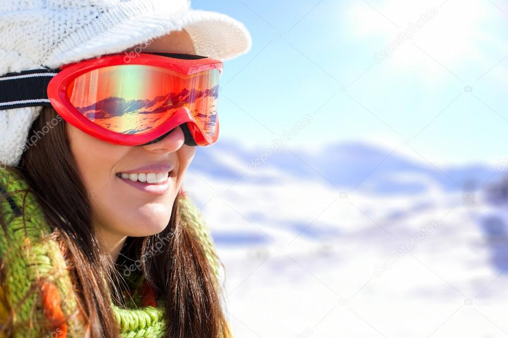 Young female skier with goggles.