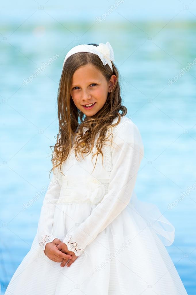 Portrait of cute girl in communion dress.