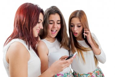 Teen girlfriends playing on smart phones