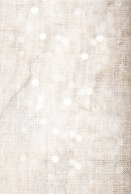 Abstract textured background: pink old canvas with white bokeh-like patterns