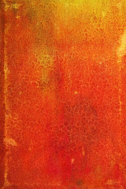 Abstract textured background: red and orange patterns on yellow leather-like backdrop