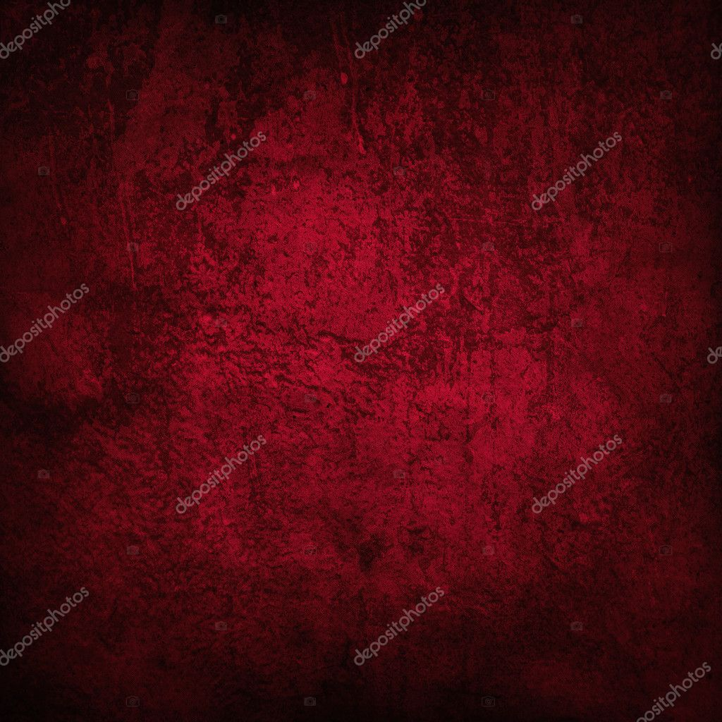 Abstract red background or paper with bright center spotlight