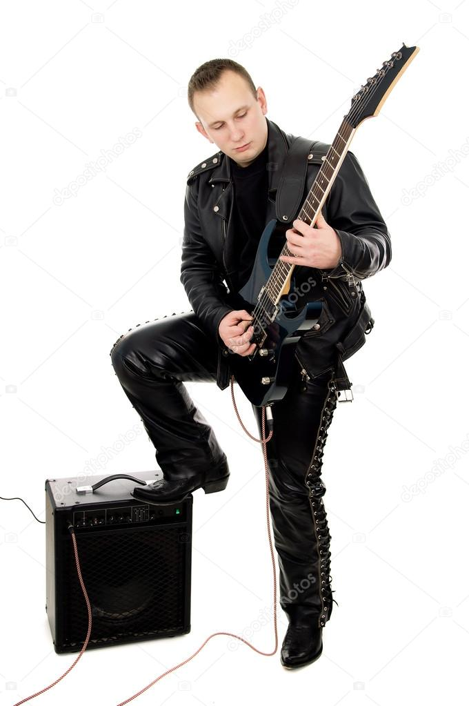 guy rock guitarist in leather garments plays guitar stock photo