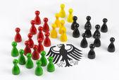 Spielfiguren mit Bundesadler