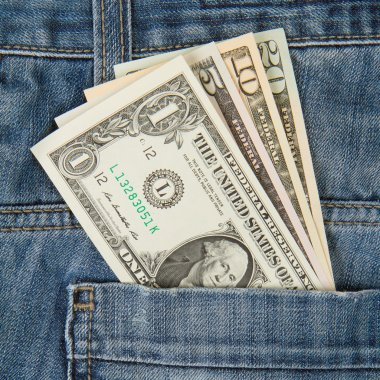Macro shot of trendy jeans with american four different dollar b