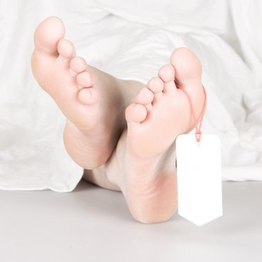 Relaxed dead body with toe tag
