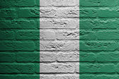 Brick wall with a painting of a flag, Nigeria