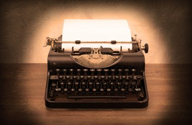 Vintage typewriter and old books