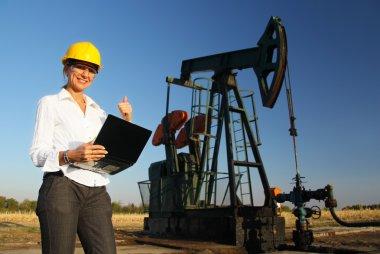 Smiling Female Engineer in an Oilfield
