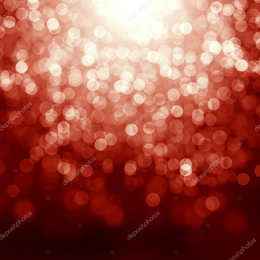 Red christmas background with defocused lights