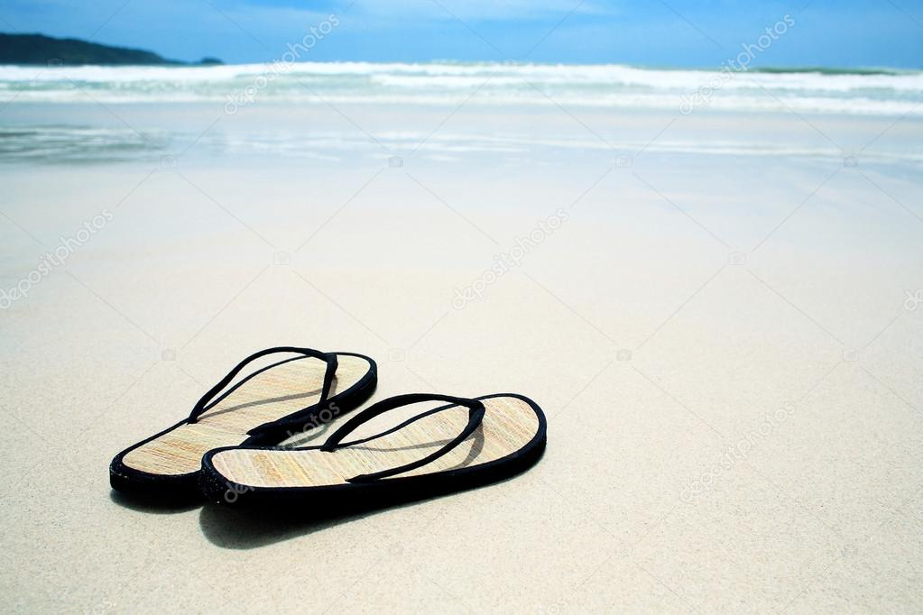Flip flops on the sand on paradise beach