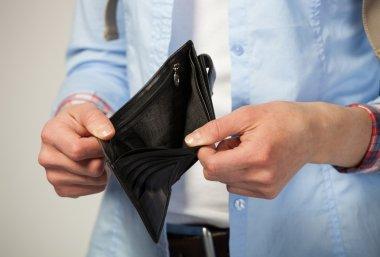 Female hands holding empty black purse