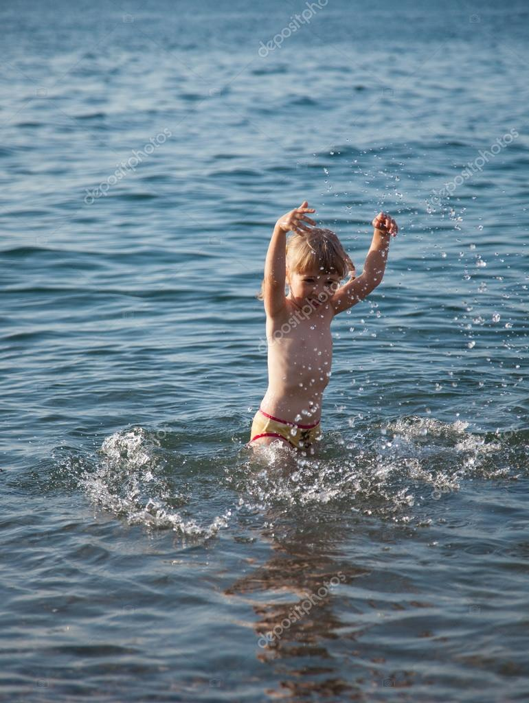 Little girl playing at the seaside