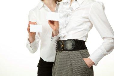 Women showing blank badges