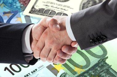 Money: euro and dollar banknotes